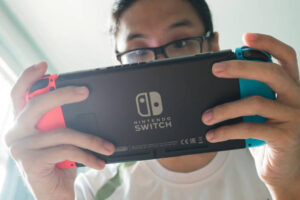 Man Playing Nitendo Switch